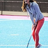 Kate laughed during an outing with Great Britain's hockey team.