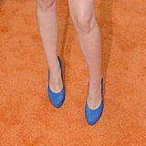 Kristen Stewart paired her Stella McCartney dress with blue suede Barbara Bui heels.