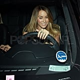 Lauren Conrad drove away in her black vehicle.