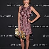 Miranda worked a floral Louis Vuitton shift, complete with cascading front ruffles at a party for the brand in NYC. She finished the look with gold-trim peep-toe pumps and a guilded Louis Vuitton clutch.