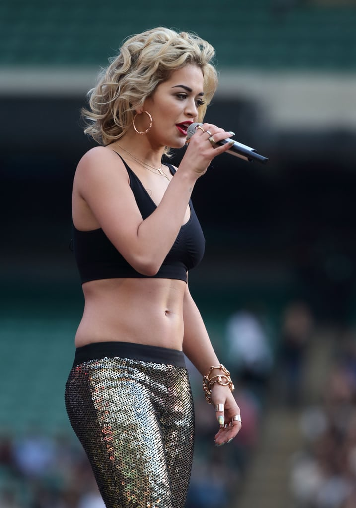 Then she removed her blazer to reveal an on-trend black crop top — and her toned midriff.