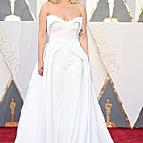 Walking the red carpet for the 2016 Oscars wearing a white Brandon Maxwell jumpsuit that came with a skirt.