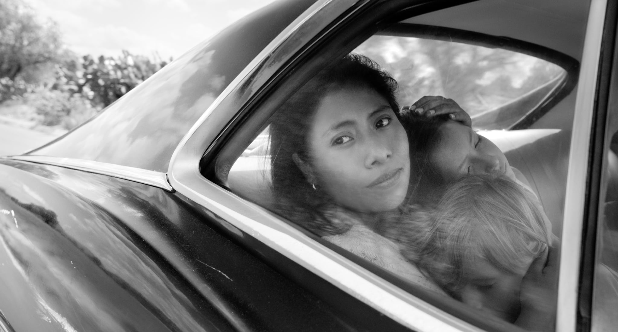 ROMA, Yalitza Aparicio (top left), Daniela Demesa (dark hair, right), Marco Graf (bottom right), 2018. ph: Alfonso Cuaron /  Netflix / courtesy Everett Collection
