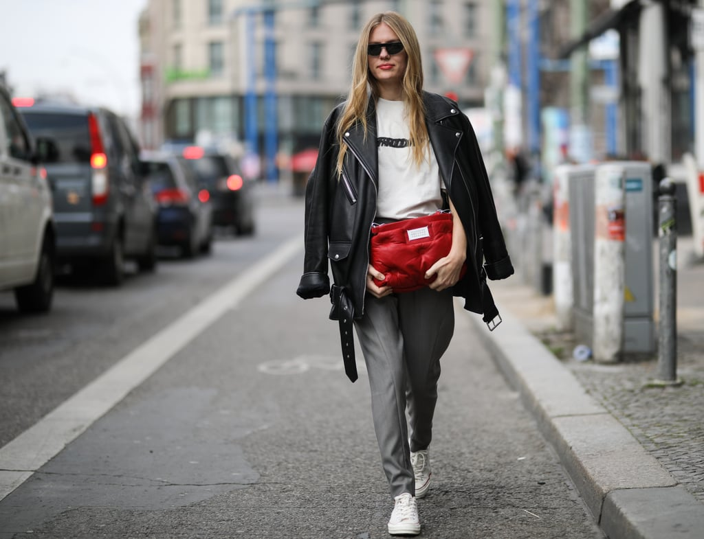 Wear your leather jacket over your shoulders and style it with a white tee and slacks.