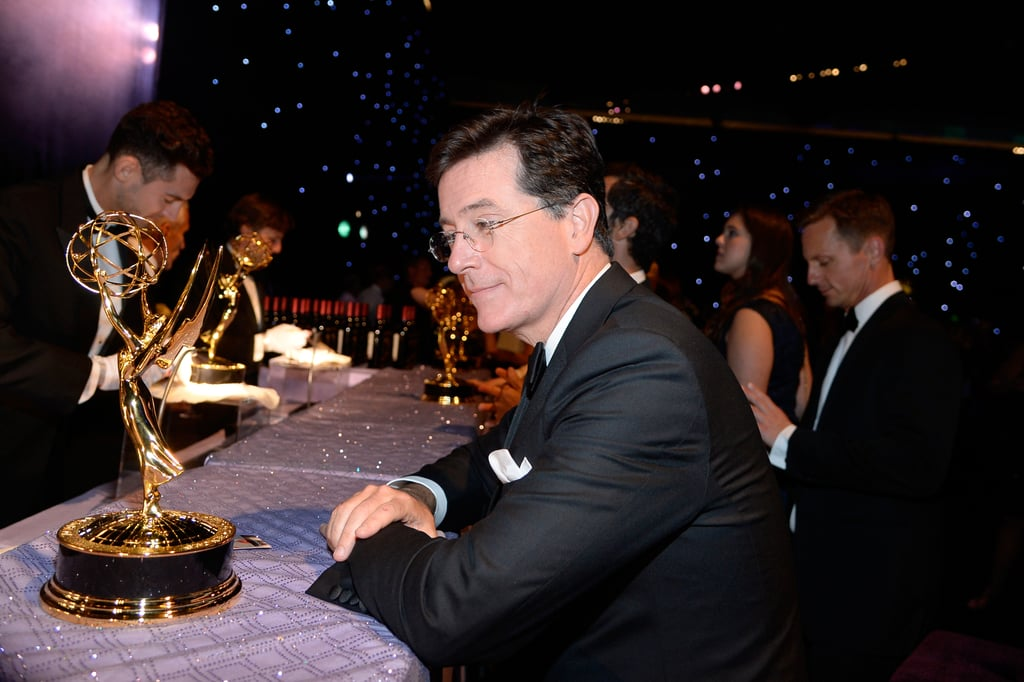Stephen Colbert looked at his award at the 2013 Emmys Governors Ball.