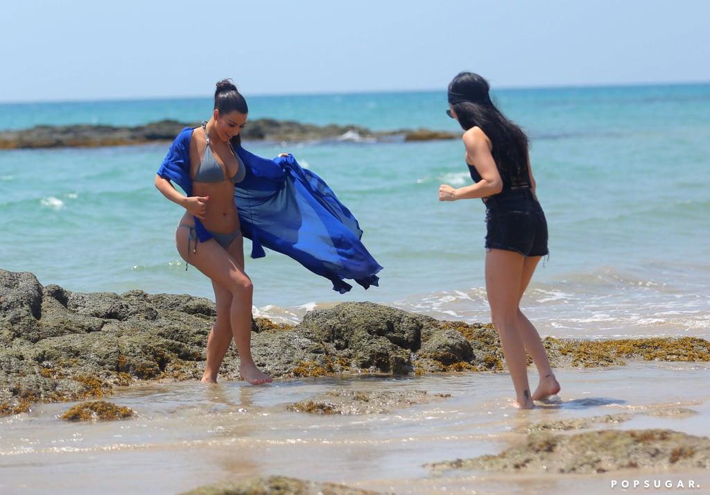 Kim walked through the water in her bikini.