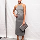 Rocking a sporty-sleek look, Zoe wore a gray head-to-toe Michael Kors ensemble to his Spring '12 runway show.