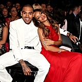 Chris Brown and Rihanna cuddled up in the front row.