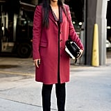 Shiona Turini dressed up her trousers with a cranberry coat and a pair of ultrachic black-and-white heels.