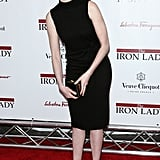 Anne Hathaway played with photographers at the Ziegfeld Theater in NYC.