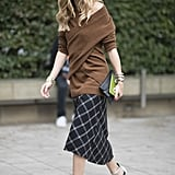 Hack: Dress up your coziest sweater with a skirt and heels for an unexpected outfit.