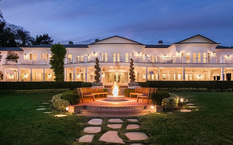 The 30,000-square-foot estate is even more beautiful lit up at night.