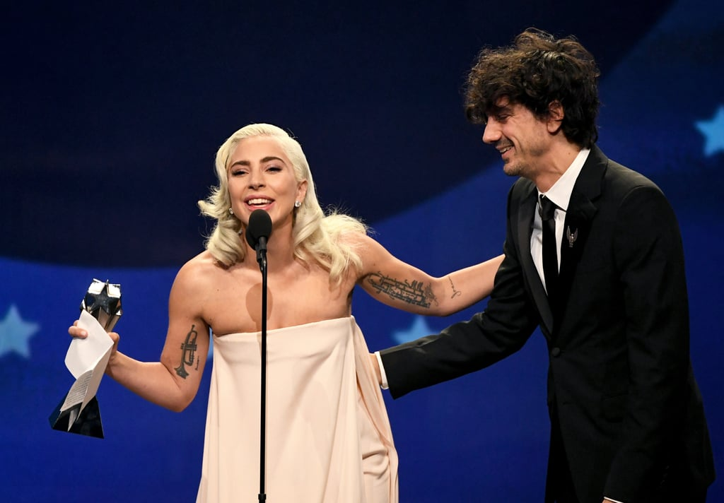 "Lady Gaga knocked the socks off of pretty much everyone with her tour de force performance in A Star Is Born, which first hit theatres back in October. Now Bradley Cooper's musical drama has won another award for best song, and Gaga's acceptance speech at the Critics' Choice Awards was naturally an emotional, heartfelt affair. Gaga, wearing a truly stunning light pink gown, made sure to call out her costar and director, as well as her cowriters. ""Thank you for this beautiful award. This means the world to us. I'll never forget when we wrote this song together with Mark Ronson and Andrew Wyatt,"" the 32-year-old actress told the audience, standing alongside songwriter Anthony Rossomando. ""I'll never forget playing it for Bradley for the first time and seeing his face light up and then singing it live together, take after take . . . I was mesmerised both as myself and as my character Ally. I was basking in the brilliant transformation of Bradley into Jackson Maine, singing on his stage, and overwhelmed by the storytelling and power in his voice."" She went on to note the inspiration behind the song, which, if you've seen the film, is pretty beautiful. ""This song is a conversation between men and women, asking each other questions about life . . . and the shallowness of a modern era,"" she said. ""I'm so happy it resonated with you."" Scroll through photos from the Enigma star's acceptance speech ahead, and then check out all the other lucky winners who took home an award at the big event on Sunday night.      Related:                                                                                                           Presenting the 2019 Critics' Choice Awards Winners, So Far"