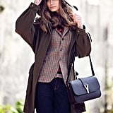 Mix up your workwear when you inject a classic plaid vest layered under a great coat and paired with your favorite denim.