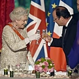 Queen Elizabeth II and French President Francois Hollande share a toast in 2014.