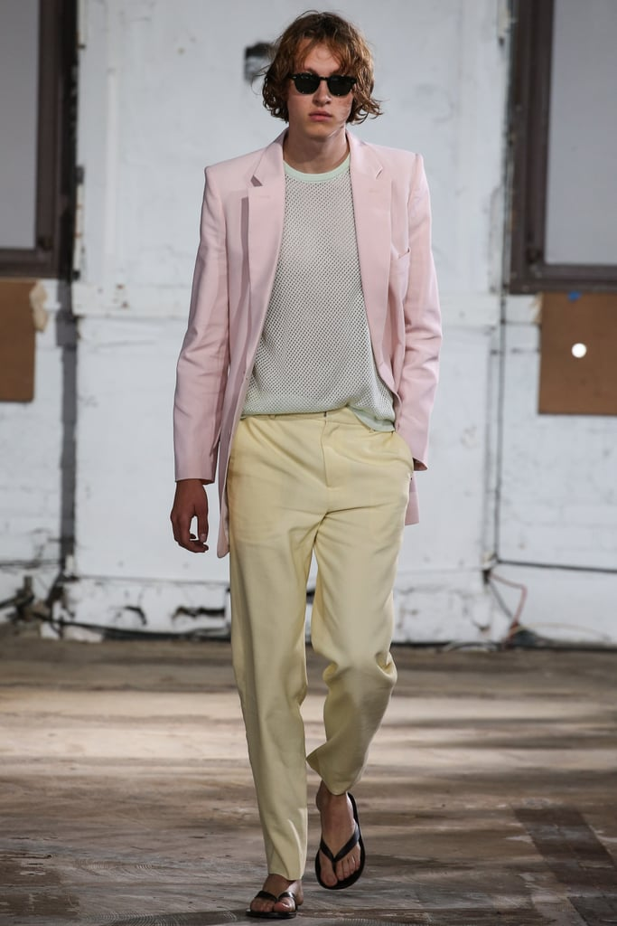 A model at the Tibi show pairing a pink blazer with yellow pants and black flip flops.