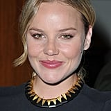 Abbie Cornish lends a modern, tribal-inspired touch to a sheath dress with a black and gold House of Lavande necklace.