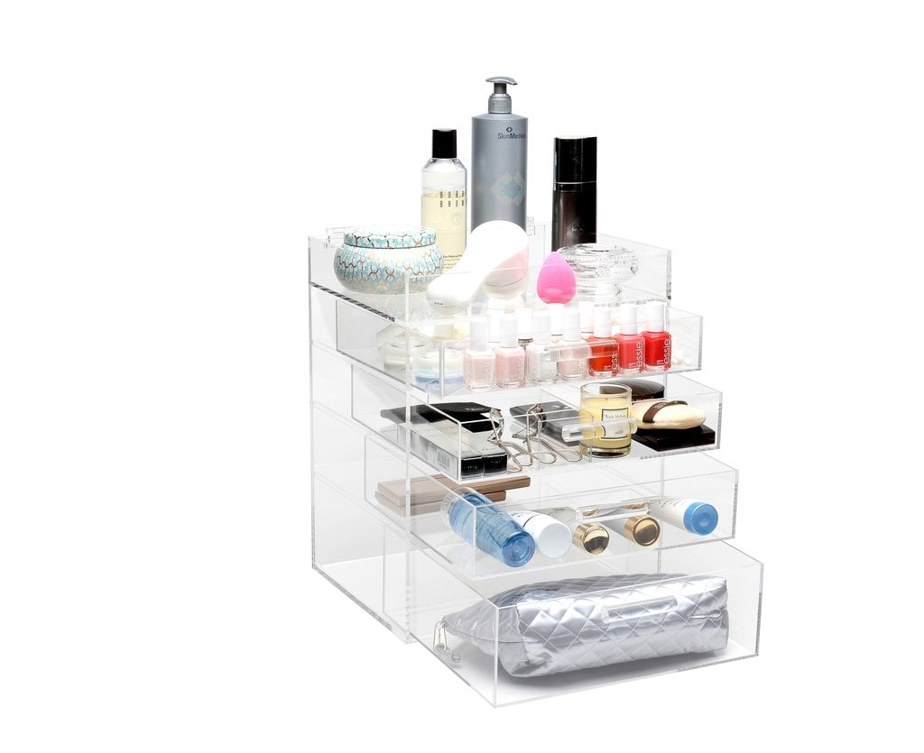 "Favorite organizers: ""The Alex 9 Drawer is essential for a big collection but I also love the GLAMluxe organizer by GlamBoxes (starting at $199). I LOVE it! It's acrylic, so you get to see your makeup. Often if I don't see it in front of me it's like it doesn't exist. It's so pretty, I keep this on my vanity. I keep my every day makeup in here as well as new launches to be tested. Another favorite is the Lady Moss Mega Lipstick Tower ($83, originally $100). If you're a lipstick junkie, like I am, this is a great way to visually store all of your lipsticks. I put mine in so the label is facing outward and you can easily read the shade names."""