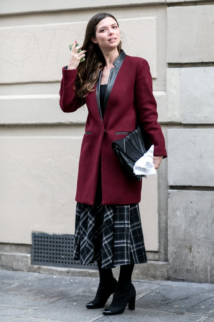 Masculine-meets-femme in the form of an overcoat and midi skirt.