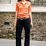 Go For a Menswear-Inspired Look With an Orange Striped Shirt, Dark Denim, and Loafers