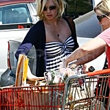 Pregnant January Jones grocery shops.