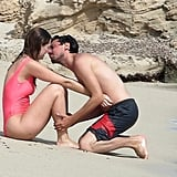 Mischa Barton wore a hot-pink swimsuit and hit the beach with her boyfriend, Sebastian Knapp, during their July stay in Ibiza.
