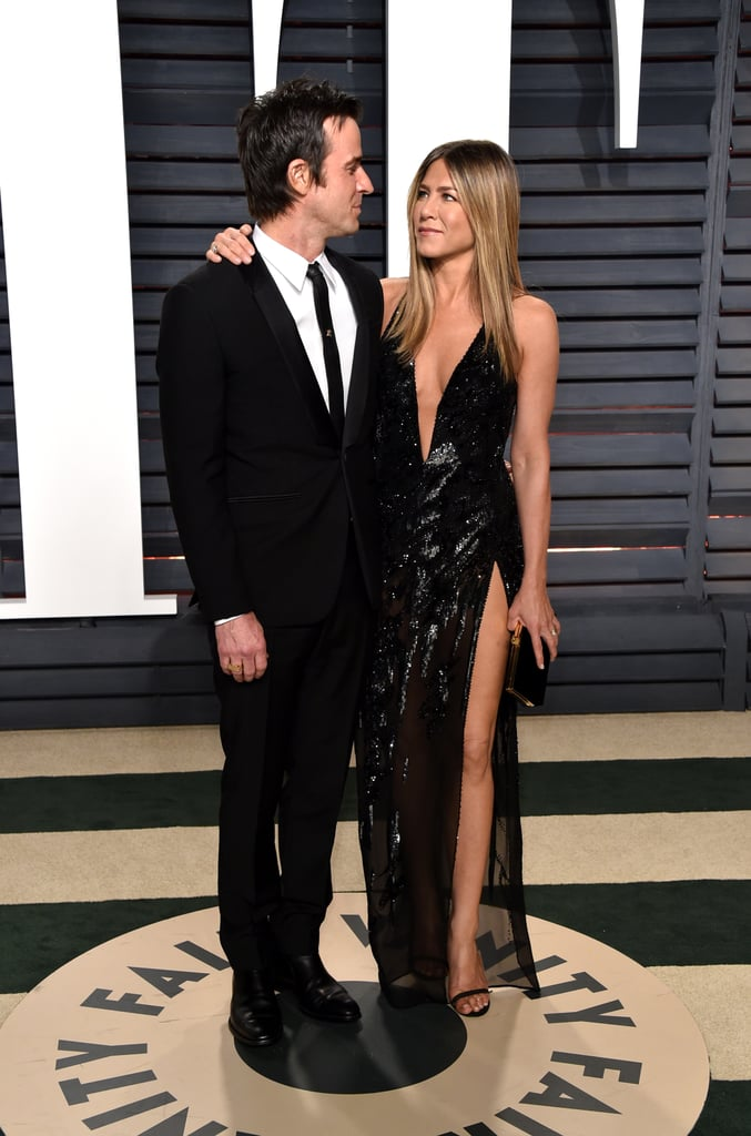 Jennifer Aniston and Justin Theroux may have skipped the Oscars red carpet on Sunday, but they certainly made up for it at Vanity Fair's annual afterparty. Jennifer turned up the heat in a black Versace gown with a plunging neckline, while Justin looked dapper in a black suit. At one point, the couple — who recently returned from Mexico — even shared a sweet moment in front of photographers as they gazed lovingly into each other's eyes. We haven't seen Jen look this sexy in a while, but we definitely aren't complaining.