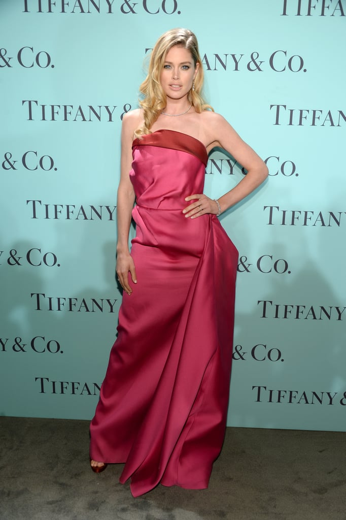 Doutzen Kroes donned a bold pink strapless dress featuring an exaggerated hip detail.