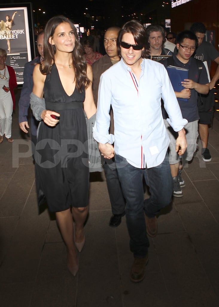 Katie Holmes and Tom Cruise leave a premiere.