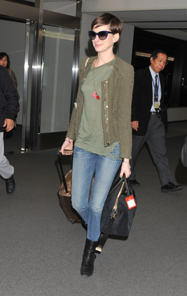 Anne Hathaway toted her luggage.