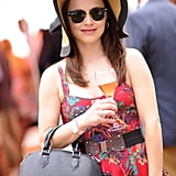 Sasha Cohen sipped Champagne while exploring the event.
