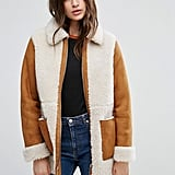 Top off any look with this ASOS Faux Shearling Coat ($111) for an instant luxe vibe.