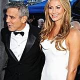 George Clooney and Stacy Keibler talked to friends on the red carpet.