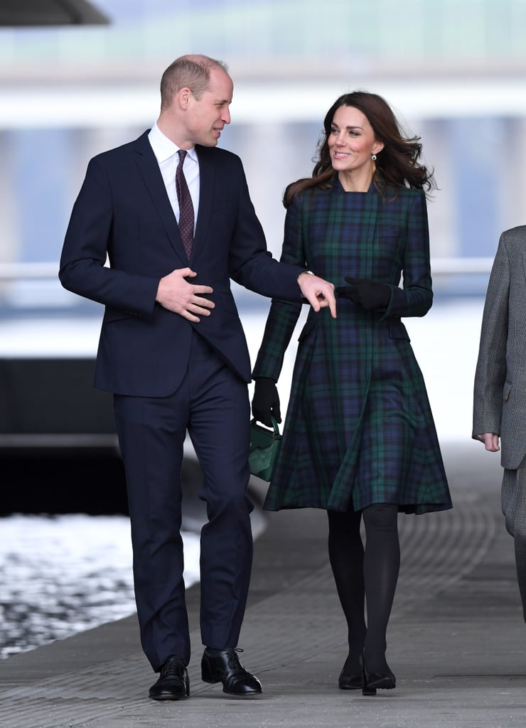 On Tuesday, the Duke and Duchess of Cambridge returned to Dundee, Scotland, after their last visit to the city in 2015. Their visit began with the official opening of the new V&A Dundee museum, which no doubt has special meaning to William, as the V&A was founded by his ancestors Queen Victoria and Prince Albert. Dundee is also only a short hop from the University of St. Andrews, where the couple first met. On their visit, Kate and William took a rather windy-looking tour of the museum, before meeting with members of the public on the waterfront. Their second visit of the day will involve a meeting with workers from Dundee's Michelin factory, which is set to cease tire production in 2020. William and Kate will speak with an action group that is working to repurpose the site and create new employment opportunities. The whole of the royal family has had a busy start to 2019. Kate has been focusing on the charities close to her heart, while her sister-in-law, Meghan, has begun working with her new royal patronages, one of which included cuddling cute dogs. Things aren't set to slow down any time soon, with a whole host of royal appearances on the calendar for the coming weeks. Ahead, get a look at all the photos from the Duke and Duchess's latest royal engagement and get the details on Kate's tartan coat and cherished earrings.