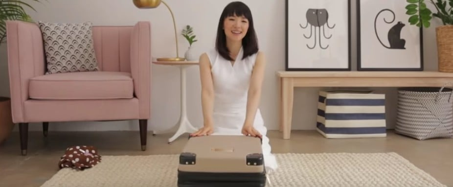 Marie Kondo Packing a Suitcase
