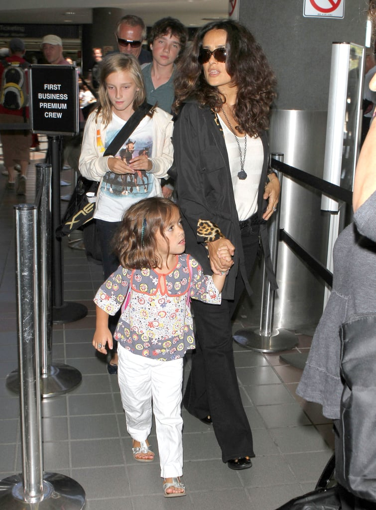 Salma Hayek and her daughter, Valentina, held hands yesterday arriving at LAX prior to boarding an afternoon flight. The mother-daughter duo were joined by their number one guy, Francois-Henri Pinault, who cared for their luggage and carry-on items while the girls made their way through security. It's been a busy Summer for the family of three. Salma began rehearsing for her role in Oliver Stone's Savages then graced the September cover of Allure. It wasn't all work, though, besides hitting the court for an occasional tennis match Salma was able to escape on a relaxing trip to Bora Bora where she reportedly stayed at the islands luxurious Four Seasons Resort.