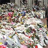 Walking among the floral tributes outside Buckingham Palace following the death of Diana in 1997.