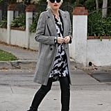 For her sleekest outfits, Gwen's go-to coat of choice is a tailored blazer done long. This gray plaid version has a touch of menswear inspiration but is made for the power woman.