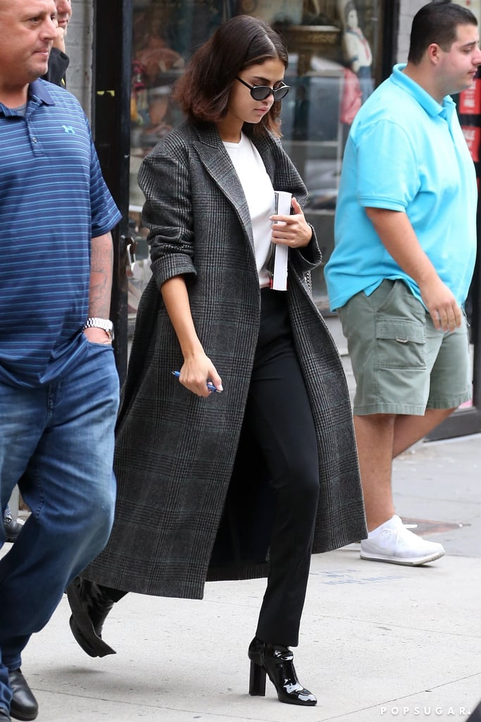 She Also Wore It With a White Shirt, Black Jeans, and Ankle Boots