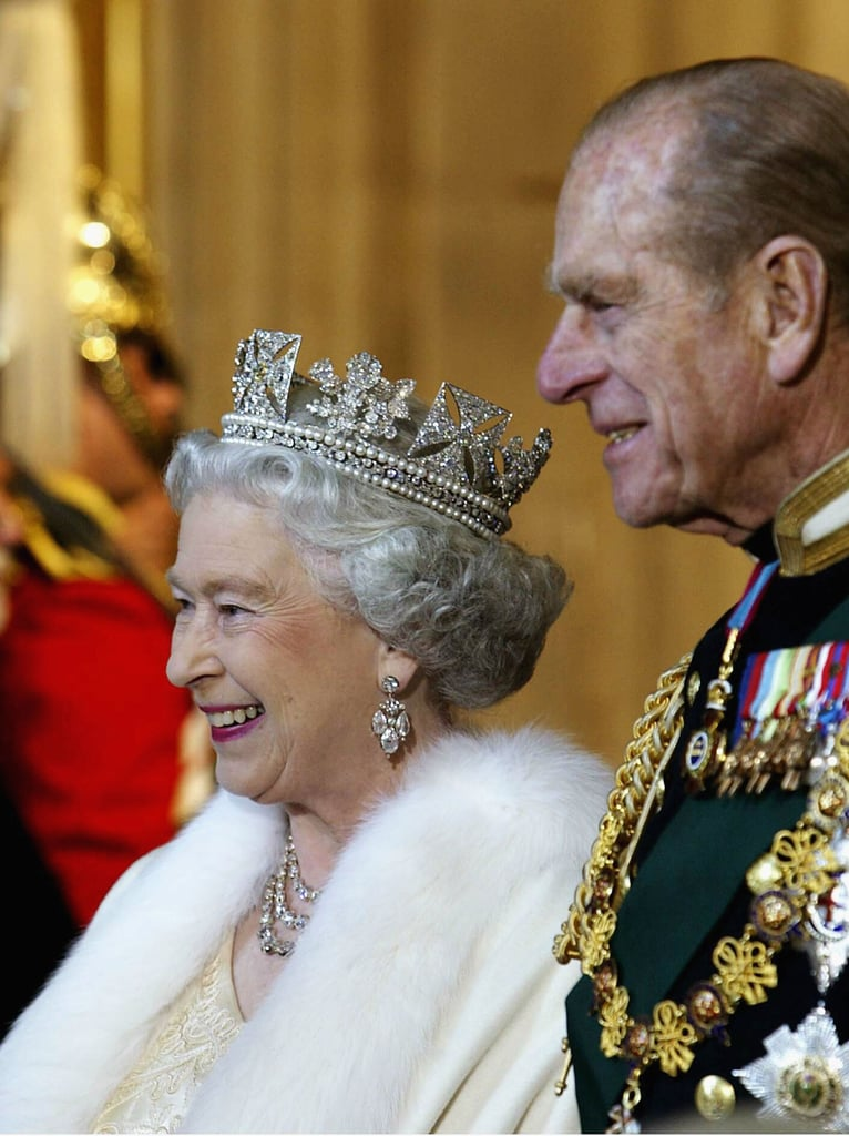 The Queen of England and her husband smiled at the state opening of parliament on Nov. 13, 2002, in London.