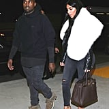 For a trip to LAX, Kim worked a fur; Kanye worked his hoodie.