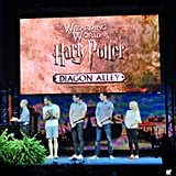 Evanna Lynch (Luna Lovegood), Matthew Lewis (Neville Longbottom), James Phelps (Fred Weasley), and Oliver Phelps (George Weasley) made a surprise announcement that the official opening of The Wizarding World of Harry Potter: Diagon Alley would be July 8.