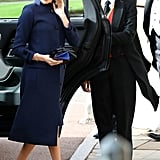 The Duchess of Sussex looked elegant at Princess Eugenie's October 2018 wedding wearing a Givenchy dress with a navy coat and her trusty Manolo Blahnik heels. She accessorised the look with a bespoke hat by Noel Stewart.
