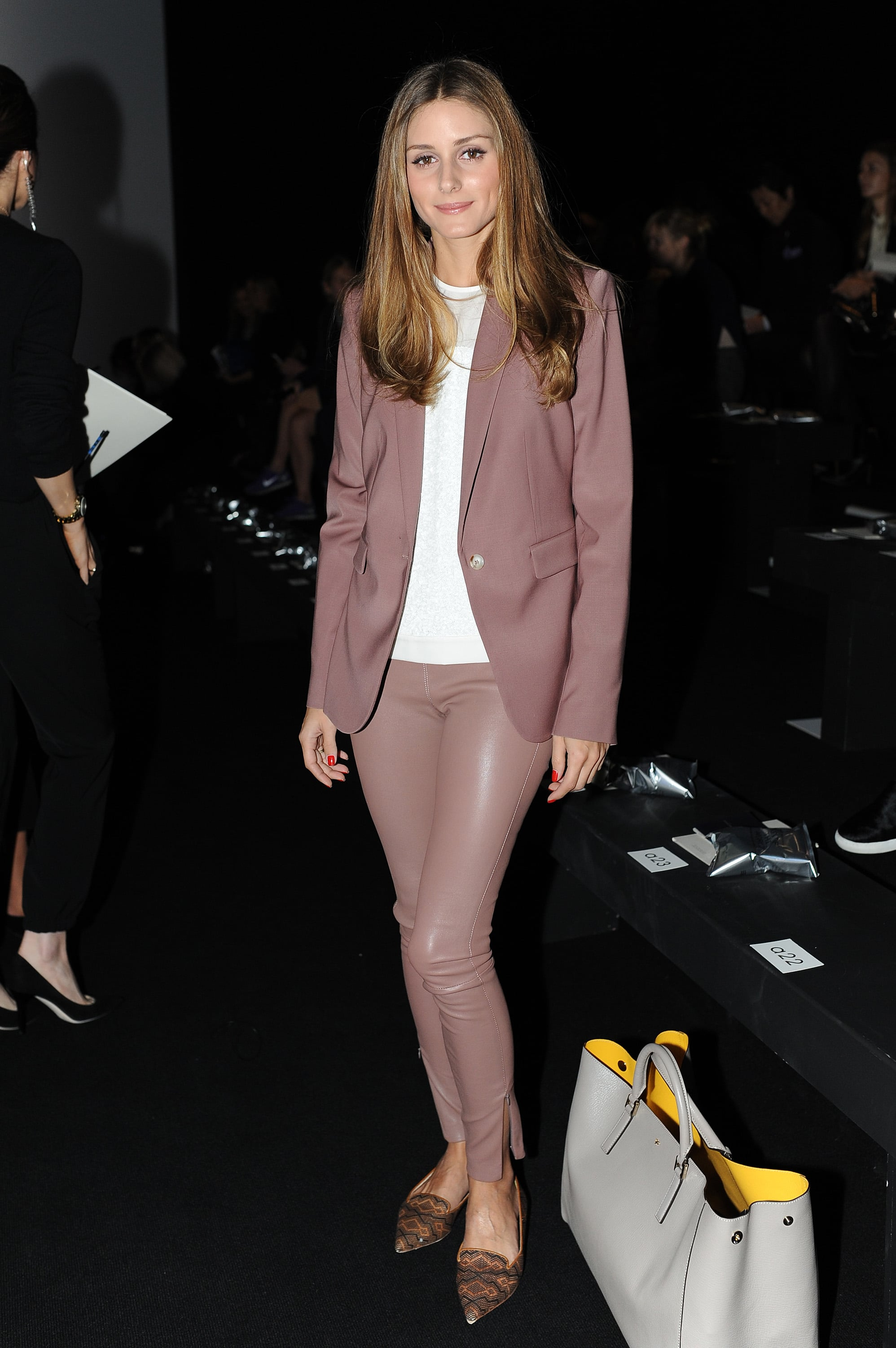Olivia Palermo's monochromatic mauve made us want to pick up a pair of purple leather leggings at the Anya Hindmarch London Fashion Week show.