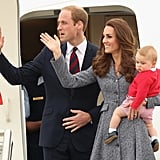 Kate Middleton in a tweed coat dress with Princes William and George in April 2014 arriving in Canberra, Australia.