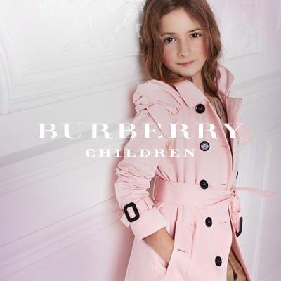 Although a child, this little lady shows a great sense of style and sophistication. Her pink washed gabardine trench is classic yet girlie. The knotted detail on the jacket shows the unique aspect of this traditional look.