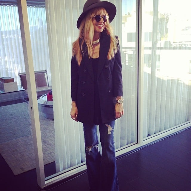 """Rachel Zoe posed for a photo while describing her """"perfect casual look"""" of wide-leg jeans and a blazer from her own collection. Source: Instagram user rachelzoe"""