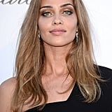 Model Ana Beatriz Barros went for soft waves with shimmering bronzed lids.