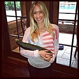 Kristin Cavallari cradled a giant zucchini. Source: Instagram user kristincavofficial