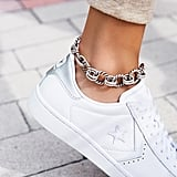 Free People's Chain Link Metal Anklet ($28) is an unexpectedly chic way to wear a little heavy hardware.
